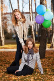 Young girls with a balloons in autumn park Stock Images