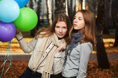 Young girls in autumn park Royalty Free Stock Images