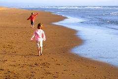 Young Girls on Beach. Young girls running on beach looking at ocean Stock Photography