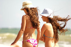 Young girls on beach. On sun light Royalty Free Stock Image