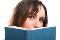 Young girls beautiful green eyes reading a book Royalty Free Stock Photography