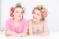 Young girls in bed at pajama party Stock Photos