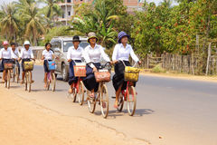 Young girls bicycle home from school Stock Image