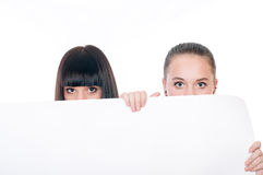 Young girls with a big  paper Royalty Free Stock Photo