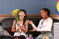 Young girls birthday party fun. Two young girls have fun and laughter at a birthday party stock photography