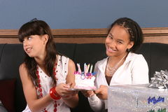 Young girls birthday party fun. Two young girls have fun and laughter at a birthday party royalty free stock photos