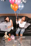 Young girls birthday party fun. Two young girls have fun and laughter at a birthday party royalty free stock photo