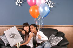 Young girls birthday party fun. Two young girls have fun and laughter at a birthday party royalty free stock image