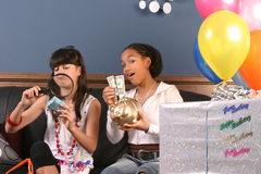 Young girls birthday party fun. Two young girls have fun and laughter at a birthday party stock photo