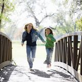 Young Girls On Bridge Royalty Free Stock Photography