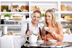 Young girls in cafe Stock Images