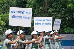 Young girls carrying Kanyashree placards royalty free stock photo