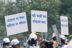 Young girls carrying Kanyashree placards royalty free stock images