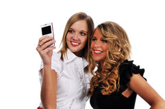 Young girls with cell phone Royalty Free Stock Images