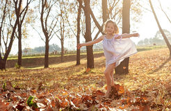 Young girls children kids playing running in fallen autumn leave Stock Photo