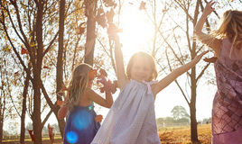 Young girls children kids playing running in fallen autumn leave. S stock photos