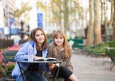 Young girls in city park Royalty Free Stock Image