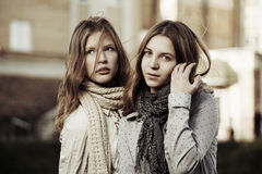 Young girls on the city street Stock Photos