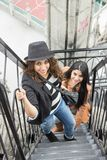 Young girls climbing stairs. Two young latin girls climbing stairs outdoors royalty free stock photography