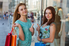 Young girls with colorful shopping bags. Season of sales. Stock Photos