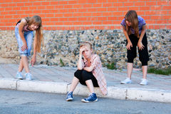 Teen girls in conflict at the school building Stock Photo