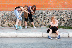 Young girls in conflict at the school building Royalty Free Stock Image