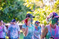 Young Girls In Costume In Color Frenzy Fun Run. MACKAY, QUEENSLAND, AUSTRALIA - JUNE 2019: Unidentified young girls splattered in colored powder participate in royalty free stock photos