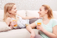Young girls on a couch Royalty Free Stock Photos
