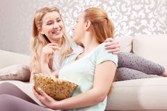 Young girls on a couch Stock Image