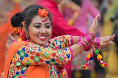Young girls dancing at Holi / spring festival. Stock Photo