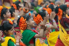 Young girls dancing at Holi / spring festival. KOLKATA, INDIA - MARCH 1, 2018 : Dancing poses of bengali girl dancers , dressed in bright sari - traditional royalty free stock photography