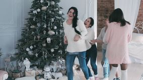 Young girls dancing near the Christmas tree stock video