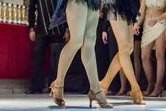 2 young girls dancing together. Female legs of young girls who dance in dance competition Royalty Free Stock Image