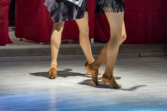 2 young girls dancing together. Female legs of young girls who dance in dance competition Stock Photos