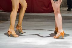 2 young girls dancing together. Female legs of young girls who dance in dance competition Stock Image