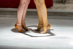 2 young girls dancing together. Female legs of young girls who dance in dance competition Royalty Free Stock Images