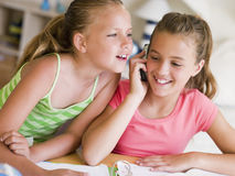 Young Girls Distracted From Their Homework Royalty Free Stock Photography