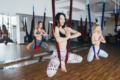 Young girls do aerial yoga in the gym Stock Images