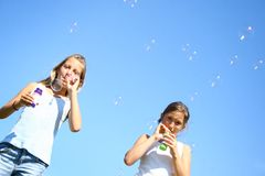 Young girls doing bubbles Stock Photography