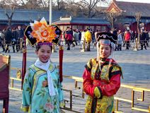 Young girls dressed in Qing Dynasty clothing in Forbidden City. Beijing, China, January 15, 2005: Young girls dressed in Qing Dynasty clothing in Forbidden City stock image