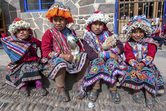 Young girls dressed in traditional Peruvian costume at Pisac in Peru. Royalty Free Stock Photography