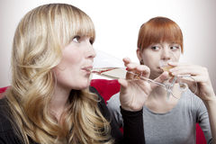 Young girls drink champagne Royalty Free Stock Images