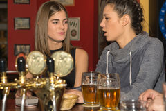 Young girls drinking and having fun together stock images