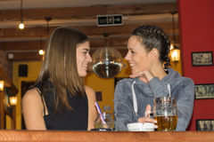 Young girls drinking and having fun together.  stock photo