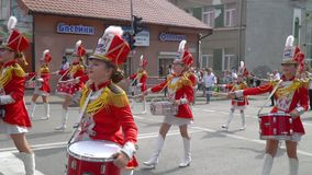 Ternopil, Ukraine June 27, 2019: Young girls drummer in red at the parade. Street performance on the occasion of the. Young girls drummer in red at the parade stock footage