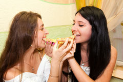 Young girls eating pizza Royalty Free Stock Photos