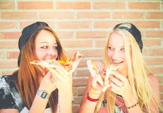 Young girls eating pizza Royalty Free Stock Image