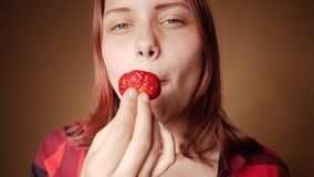 Young girls eating strawberry stock video footage