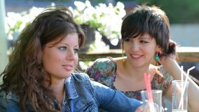 Young girls enjoying some food and drinks stock footage