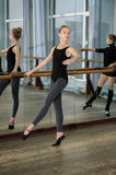 Young girls exercising during ballet class Stock Image
